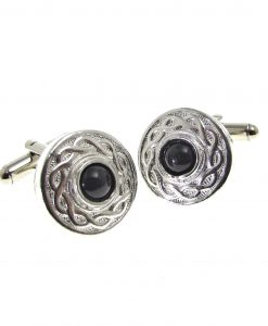 Cornish tin cuff links set with black stone cabochon.
