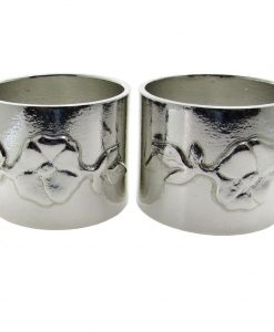 A pair of wild rose motif napkin rings cast in Cornish tin
